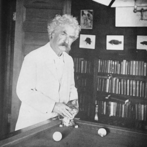 Mark Twain with Kitten on the Billiard Table