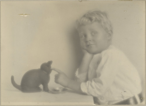 Weston's son, Brett Playing with Rubber Black Cat