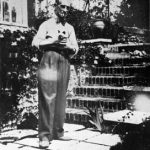 Maurice Ravel with his Siamese cat , Mouni , in 1929 . French composer
