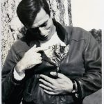 Yves Montand, Italian-French actor and singer with cat