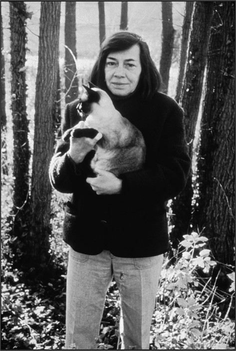 Near Fontainebleau. Patricia Highsmith and Cat, at her home Martine Franck