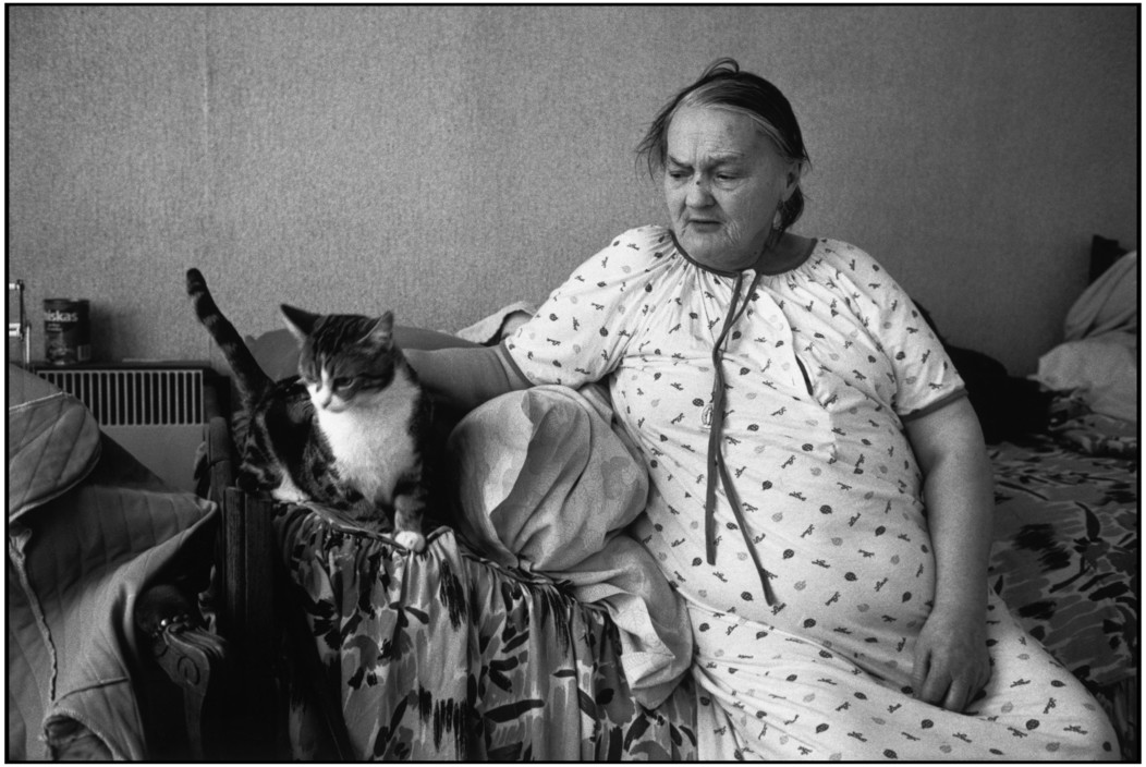 Woman and Cat, Petits frères des Pauvres association (International Federation of Little Brothers of the Poor). Home Visit. Martine Franck
